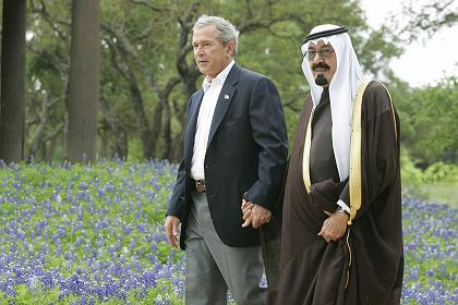 U.S. President George W. Bush walks with Saudi Arabia's Crown Prince Abdullah on his ranch in Crawford